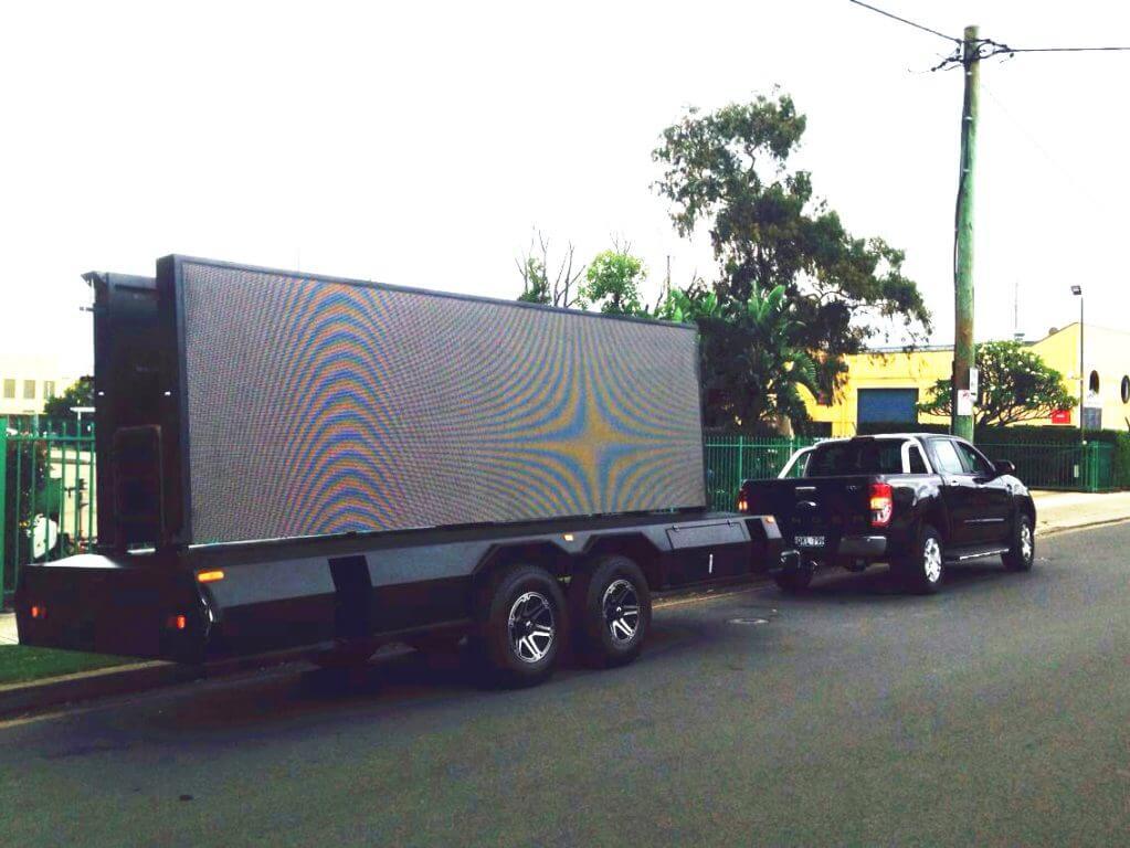 MB-16 LED billboard trailer on road