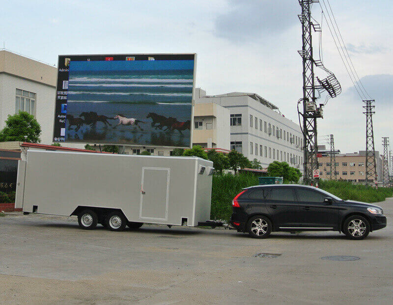 SUV is towing MB-22 mobile LED sign trailer